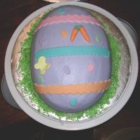 Easter Egg Easter cake for my Nanny(Grandma). Coconut cake with bc icing and fondant decos. Forgot to take a pic after I added bunnies to each side.