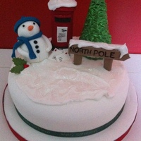 Christmas Cake Fruit cake covered in marzipan and fondant. Decorations made with 50/50. Snow effect with Royal icing.Thanks for looking.