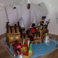 Pirate Ship I made this cake for my son's birthday. This entire cake was edible apart from some little figures that i put on it and the skull &...