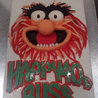 Animal From The Muppet Show   Animal cake covered in a white MMF and decorated wildly!!