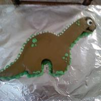 Dinosaur Cake WASC cake wit regular and chocoltae cream cheese icing. The eye is a candy melt and the spines are white chocolate chips. i got this design...