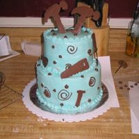 "Tool Cake My first ""decorated"" cake. I just started taking the Wilton classes, but I wanted to go ahead and try to make a two tier cake for..."