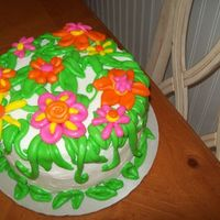 Spring Cake   Inspired by Bronwen Webers flower basket cake. I wanted to try these types of fondant flowers. Still working on techniques!