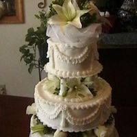 Stauffer Wedding Cake 7-7-07   Lilies and Roses with Ruffle Garland and FOndant pearls