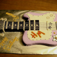 """hannah Montana"" 3D Guitar Cake  This was a Strawberry Cake with Buttercream Frosting. It was Shaped and Covered in Fondant, and Frosting to Create Guitar Details. It also..."
