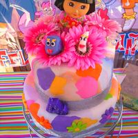 Dora The Explorer Very simple tier cake with a tie-dye patterm.