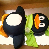 "Penguin Very simple penguin cake. For the belly I used the Wilton sports balls pan and for the head I just used a round 8"" pan."