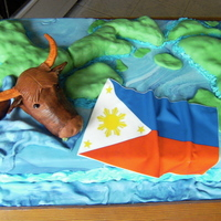 Welcome Home This cake was for a friends son who returned from his mission from the Philippine Islands. They asked for three things. The islands he...