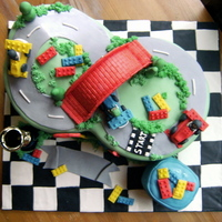 Lego Racetrack I made everything from gumpaste/fondant except the trophy. I broke the one I made and had to use a party favor in its place. TFL
