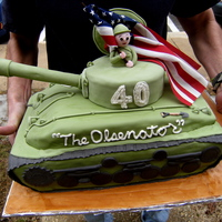 Military Tank Thanks to my husband for standing outside for a moment on his way to deliver this cake so I could take a picture. I didn't use the...