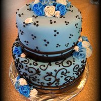 Blue   Beautiful White cake ... Butter cream icing .. and yummy coco piping