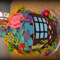 Disney Tangled   Cute lil Top' of the tower Tangled cake. White cake with butter cream icing.