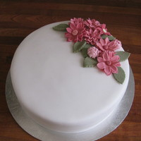 Flower Spray Pink Daisy Spray. Chocolate Cake with Bailey's Buttercream covered in white fondant