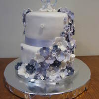 "2 Tier Triple Layer 90Th Birthday Cake 8"" and 6"" Triple Layer Vanilla Sponge Cake, covered in fondant with various shades of violet fondant flowers."