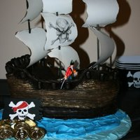 Pirate Ship  I made this cake for a friends murder mystery party: Murder Among The Mateys. It is covered with chocolate fondant. I cut out planks for...