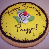 Happy Birthday Preggo Cookie Cake  This is a giant sugar cookie iced in buttercream with fondant pickles, ice cream, anchovies, and buttercream chocolate drizzle. Mmmm, mmm...