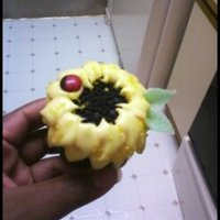 Sunflowers red velvet sunflower cupcakes made with oreos and cream cheese frosting. i used hershey's dark chocolate pieces and edible marker for...