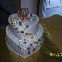 100_0924.jpg This was and anniversary cake I made for my friends parents 50th. It is iced and decorated using bettercrream icing. You have to keep it a...