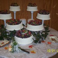 Fall Wedding Cake filled wedding cake with frosted grapes and strawberries. Done in basketweave