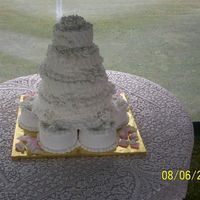 Buttercream Wedding Cake Cake was made for an outside wedding, Stacked and sitting on six six inch cakes.