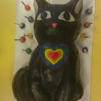 Rainbow Cat The design, including the rainbow heart, was at the specific request of the 6 year old birthday boy. It was my first fondant cake, and a...