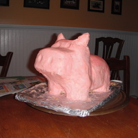 Piggy Bank Cake My second carved cake. My son loves piggy banks. :)