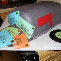 Mail Box Cake For A Dj/postal Worker Six 8 in square cakes stacked then iced in grey buttercream. Records and letters made out of fondant.