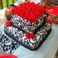 Black And White Wedding Shower Cake two tiered cake with black scroll work and red fondant roses