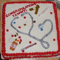 Graduation From Nursing School All of the things on the cake are made out of fondant