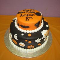 Amelia's 8Th Birthday Cake  This is a picture of my first fondant cake. My daughter wanted me to make her birthday cake and wanted a Halloween theme. She helped me in...