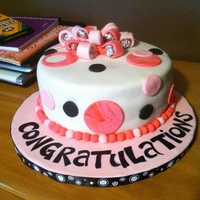 Baby Girl Chocolate cake with chocolate fudge buttercream filling. covered in MMF with fondant accents