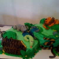 Jungle Cake   My first cake - fondant animals and accents on a butter cream cake with piping gel for water