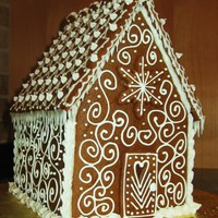 Simple Gingerbread House This was my first time doing this. I wanted to keep it very classic and elegant and I didn't have any candy to decorate with! Lots of...