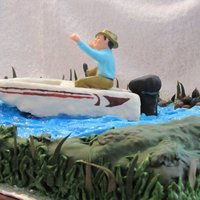 Fisherman Birthday Cake The boat and motor were sculpted out of rice krispie treat covered in fondant and hand painted. The water was blue and white marbled...