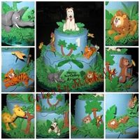 Jungle Cake   Chocolate fudge cake with vanilla buttercream frosting. Gumpaste animals and trees.