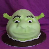 Sculpted Shrek Cake Sculpted Cake Shrek done in class at BGC. Vanilla Cake, Swiss Meringue Buttercream and Modelling Chocolate. I painted his eyes, eyebrows