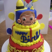 Curious George Curious George done for a 1st Birthday. Fondant covered and fondant decorations, TFL!