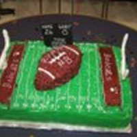 Football Birthday Cake This was made for a boy's birthday that played football. The sheet cake was half white and half chocolate. The accents are buttercream...