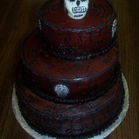 "Halloween This was created from pics on Cake Central and online cakes representing ""Dawn of the Dead"". The cake was covered in BC with MMF..."