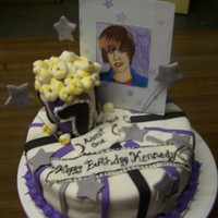 Justin JB cake done for a friend.Got the idea from another cake baker...all decorations is fondant covered. Picture is hand sketched applied to a...
