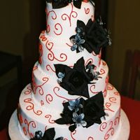 Red Swirls With Black Roses all chocolate cake with bc icing and red swirls and black roses