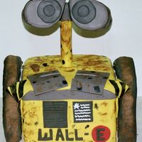 Wall-E For My Niece Head is styrofoam on a large dowel stuck through cake. Wheels are RKT, all covered with MMF.