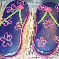 Purple Flip-Flops Yes one is bigger!!! This was just a for fun cake for my group at work, so no one cared. I just wanted the practice. The icing turned...