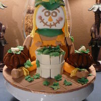 Scarecrow With Pumpkins Scarecrow is made out of rice krispies and covered with fondant. The two mini pumpkins on the side are pumpkin spice cake with honey cream...