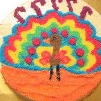 Festival Of Light - Diwali   This is an orange poppy seed cake with orange buttercream icing topped with coloured sanding sugar which i made myself :)