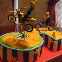 Dirt Bike Race Track Cake number 5 cake using 8 inch square and 9 inch round 2 layer cakes put together and carved. hand painted track and added some graham crackers...