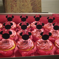 Minnie Mouse Cupcakes minnie toppers with homemade wrappers with rhinestones and bows