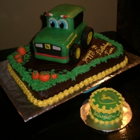 Johnny Tractor 1st birthday john deere cake with mini logo to smash