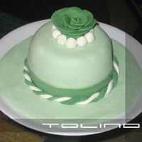 Mini Green Cake wasc with rasberry buttercream and jam filling. fondant accents. thanks for looking