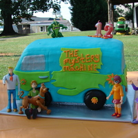 Scooby Doo Cake The Mystery Machine; 6 layers of vanilla cream cake covered with vanilla buttercream fondant.